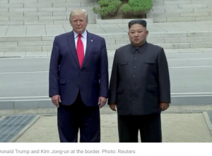 Donald Trump and Kim Jong-un at the border. Photo: Reuters