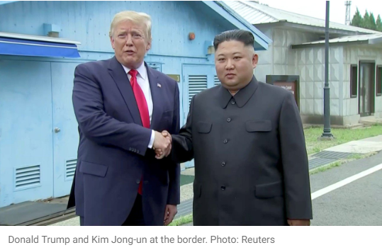 Donald Trump and Kim Jong-un shake hands at the border. Photo: Reuters